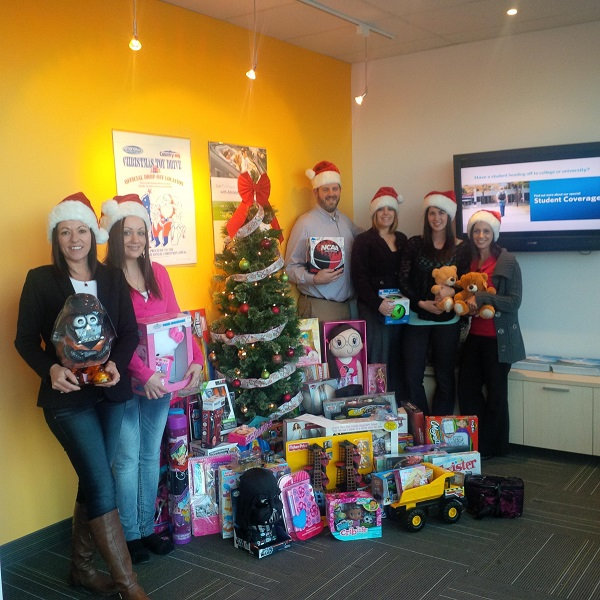 Allstate Peterborough staff with toy drive donations